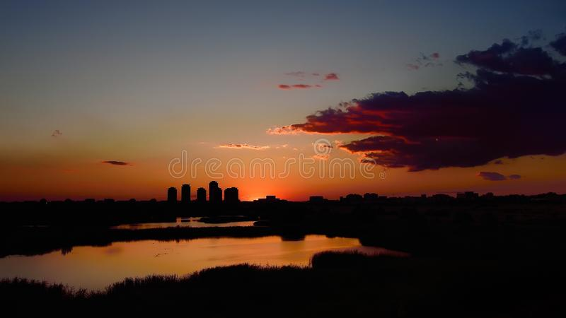 Asmita building complex with sunset silhouette, cityscape of Bucharest stock photo