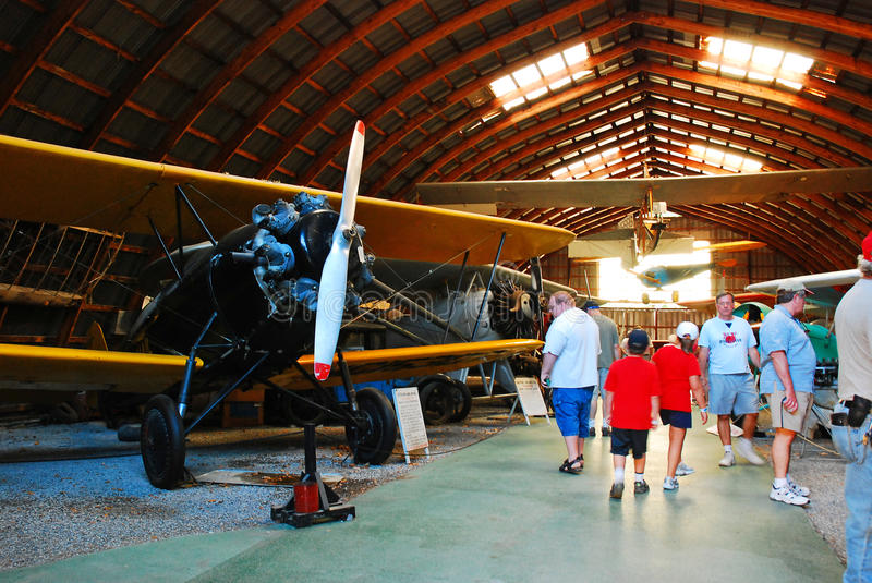 ASntique Aircraft. Visitors walk amongst the Antique Aircraft, at the Rhinebeck Aerodrome in Rhinebeck, New York royalty free stock photo