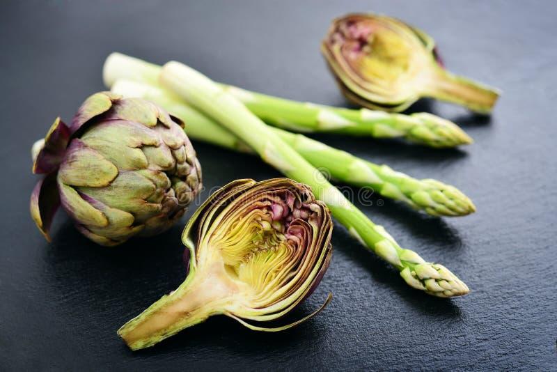 Asparagus with artichoke stock photos