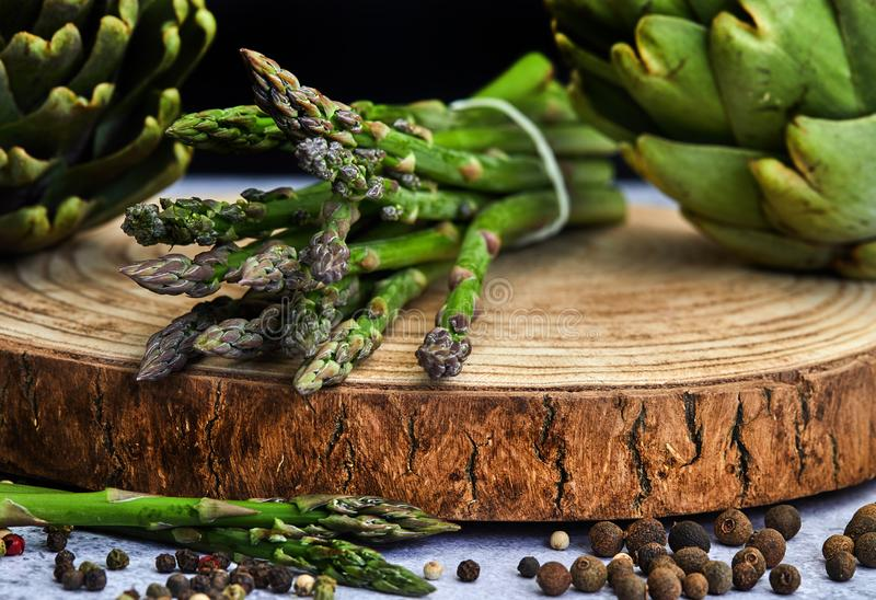 Asparagus and artichokes with herbs stock photo