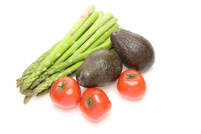 Asparagus,avocados and tomatoes in a white background stock photography