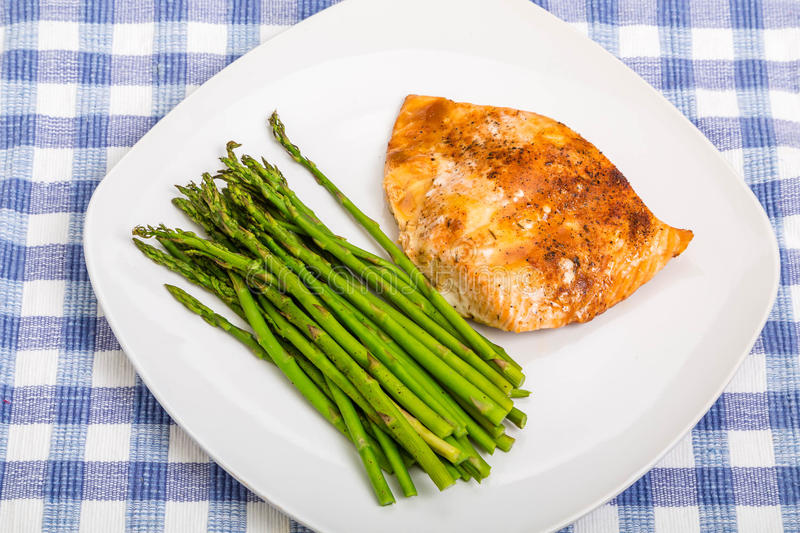 Asparagus with Baked Salmon royalty free stock images
