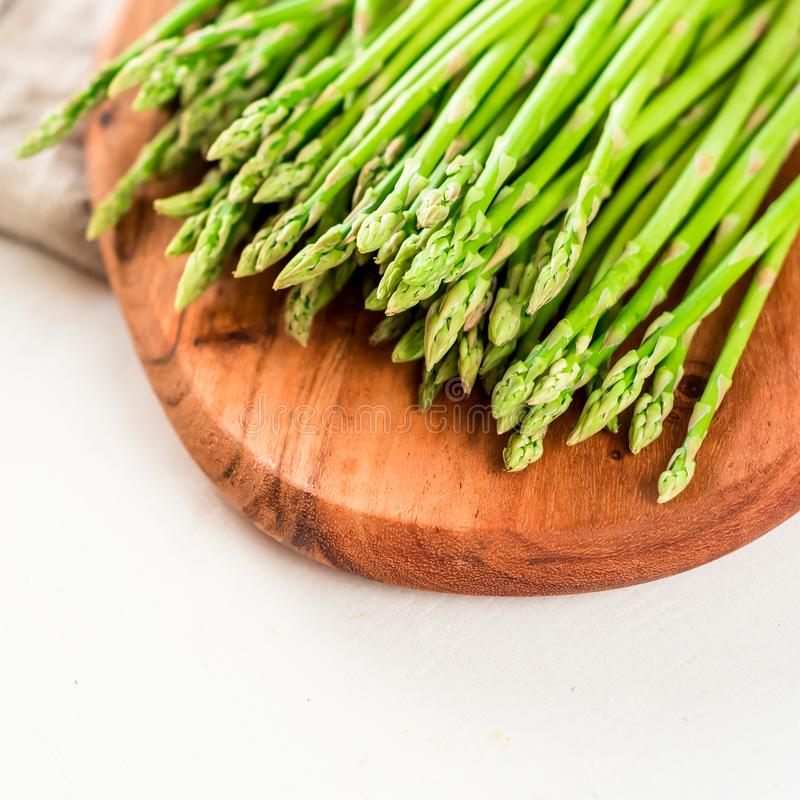 Asparagus, a bunch of fresh asparagus on a wooden cutting board stock images