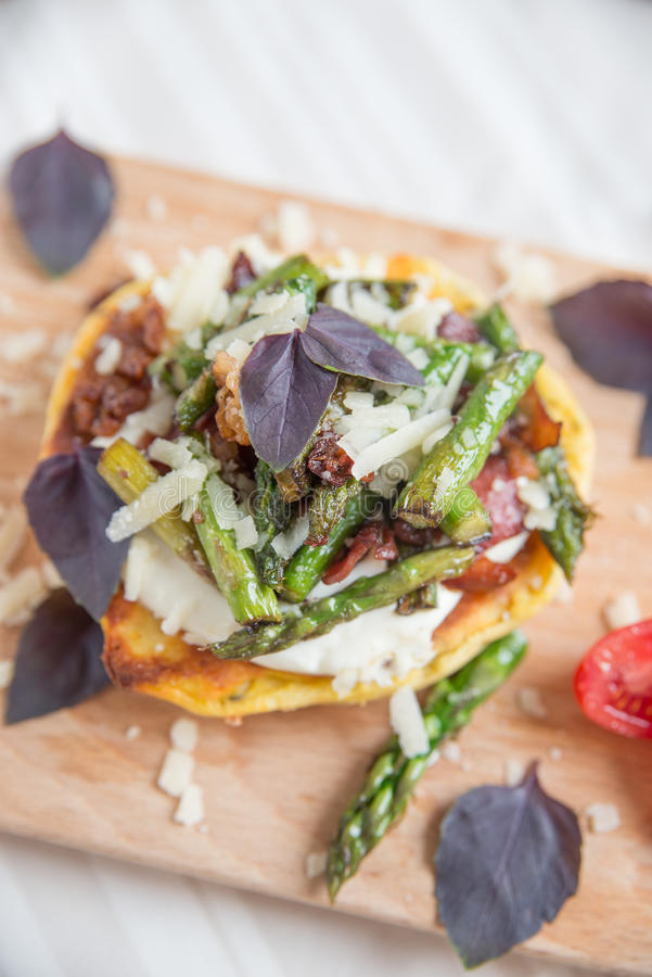 Asparagus burger. Home made healthy asparagus burger royalty free stock photos