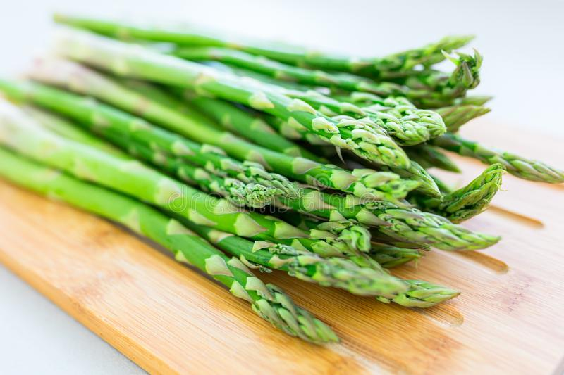 Asparagus on a cutting board in the kitchen stock image