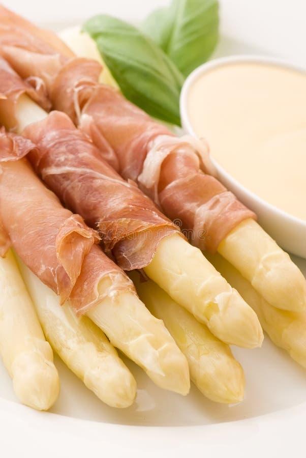 Asparagus with Gammon. And Sauce as closeup stock photography