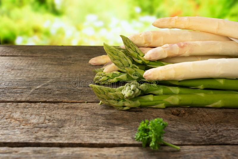 Asparagus on old wood royalty free stock photography