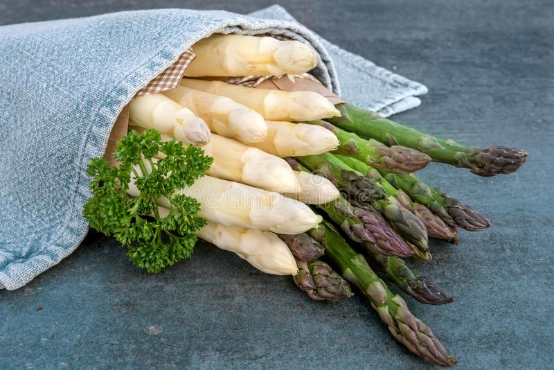 Asparagus with parsley on a stone plate royalty free stock images