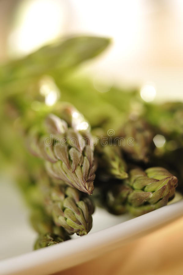 Asparagus on plate. A platfull of asparagus viewed low and close-up, with room above for copy stock photos