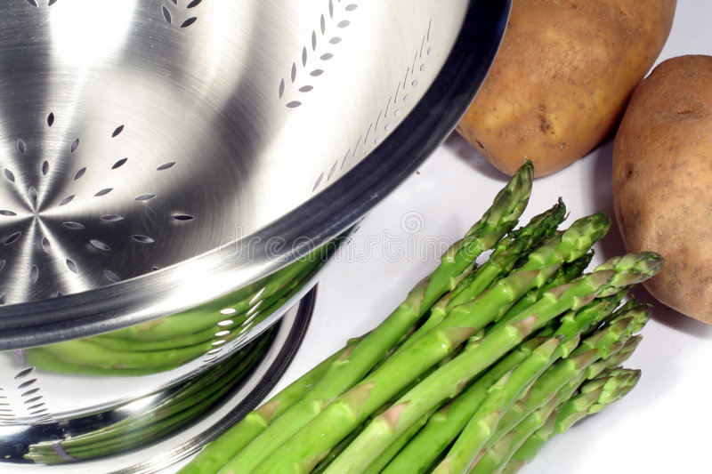 Download Asparagus, Potatoes And Colander Royalty Free Stock Photo - Image: 1706285