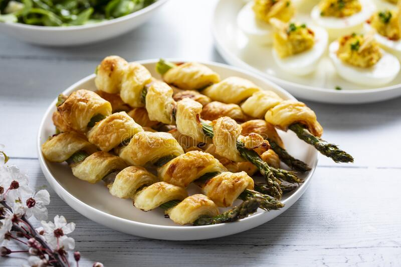 Asparagus in puff pastry stock photo