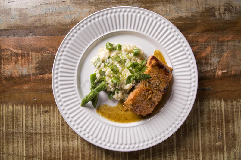 Asparagus risotto with grilled salmon stock photos