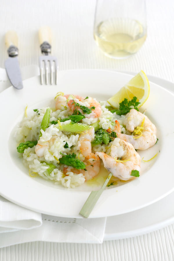 Asparagus risotto with shrimp royalty free stock photography
