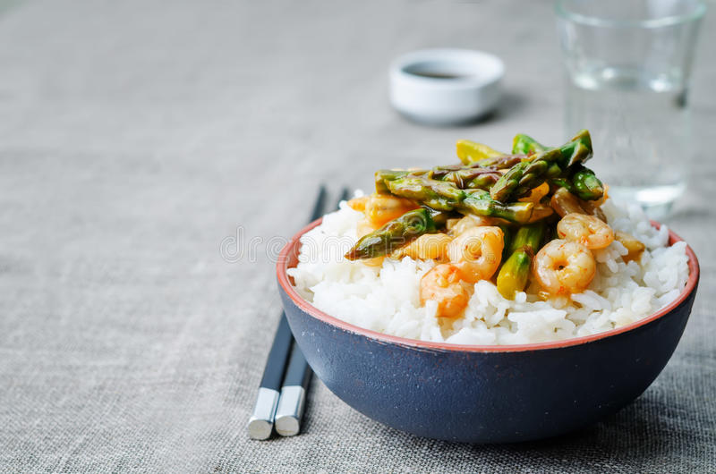 Asparagus shrimp stir fry with rice. The toning. selective focus stock photo