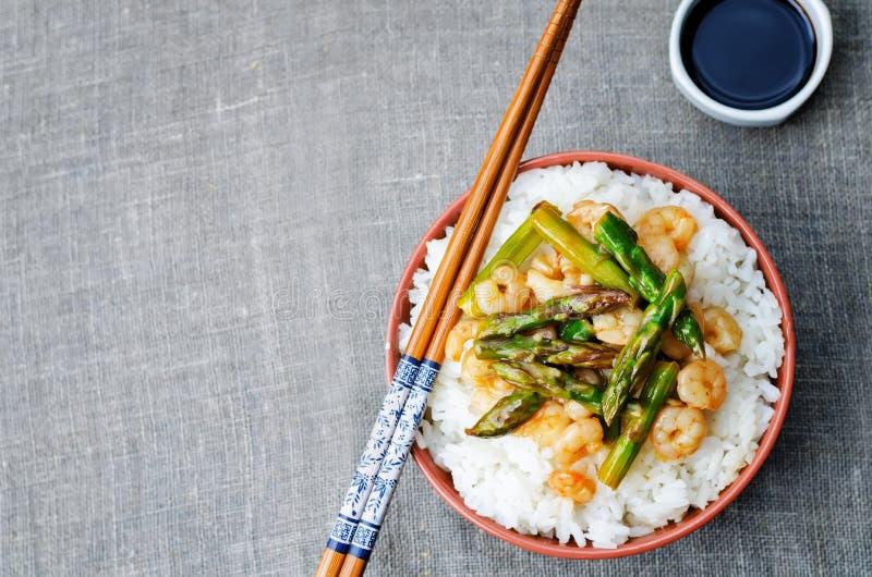 Asparagus shrimp stir fry with rice royalty free stock photography