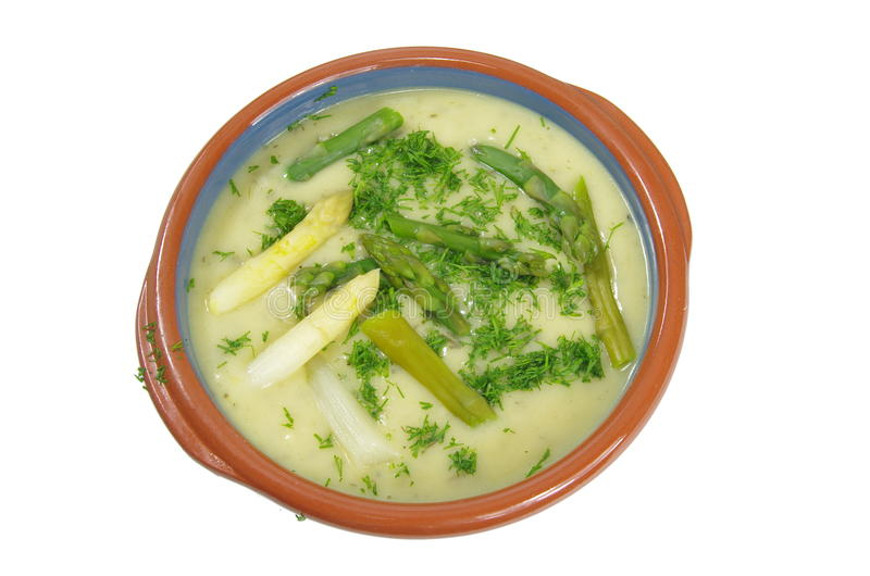 Asparagus soup. In plate on white background stock images