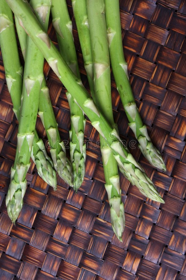 Download Asparagus Spears on Bamboo stock image. Image of wood - 4950323