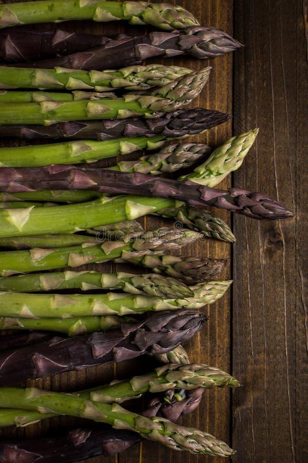 Asparagus Varieties on Dark Wooden Background stock image