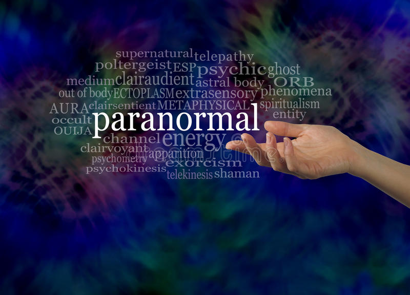 Aspect of the Paranormal Word Cloud. Female hand gesturing towards the word PARANORMAL surrounded by a relevant word cloud on a dark energy formation background royalty free stock image