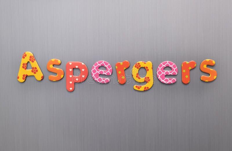 Aspergers word pisane jasnymi, kolorowymi, patterenowymi literami na szczotkowanym metalowym tle obrazy stock