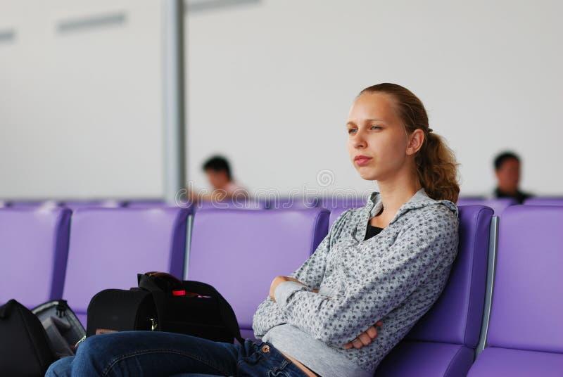 Aspettando un volo fotografia stock
