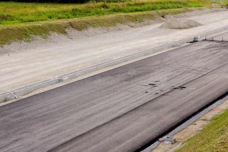 Asphalt And Asphalting The Road Stock Image