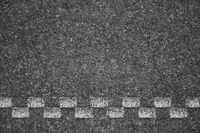 Asphalt background texture with some fine grain of road stock image