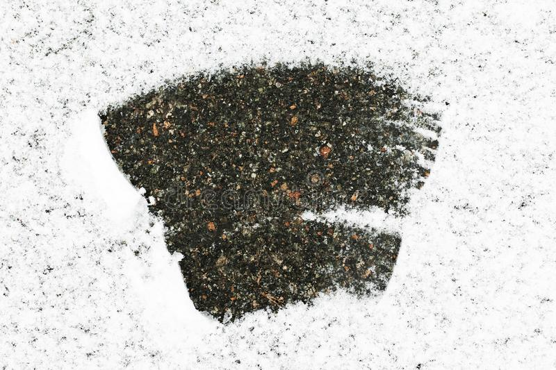 The asphalt covered with snow, lots of snow in the middle of the snow cleared, Snow background royalty free stock photo