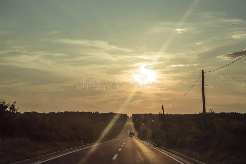 Asphalt Long Road And Vehicle Passes Through Right Lane During Golden Hour Free Public Domain Cc0 Image