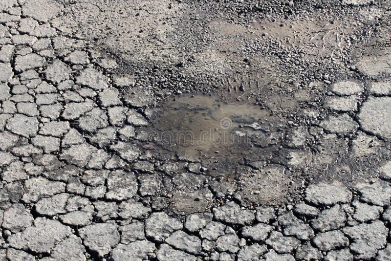 Asphalt pothole royalty free stock photos