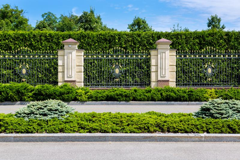 Asphalt road along the main fence with stone. stock images