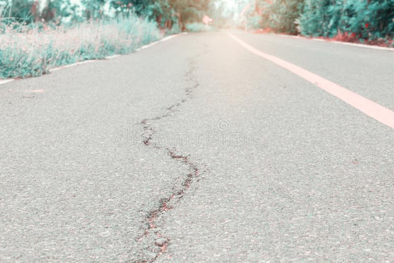 Asphalt road cracked. street highway countryside.  stock image