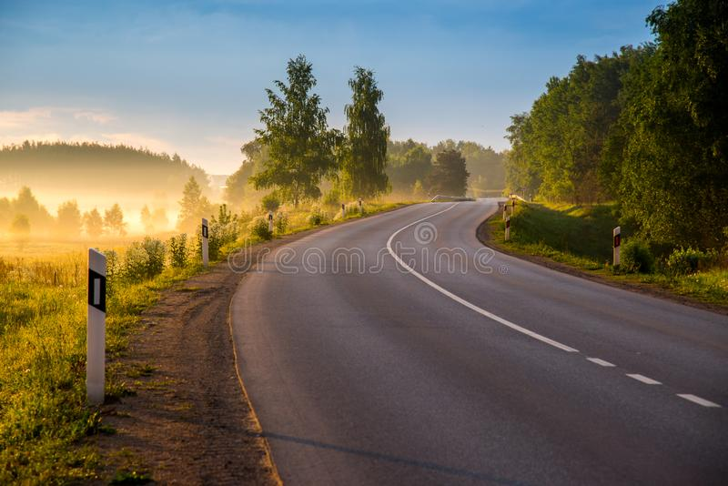 Road curve at sunrise royalty free stock images