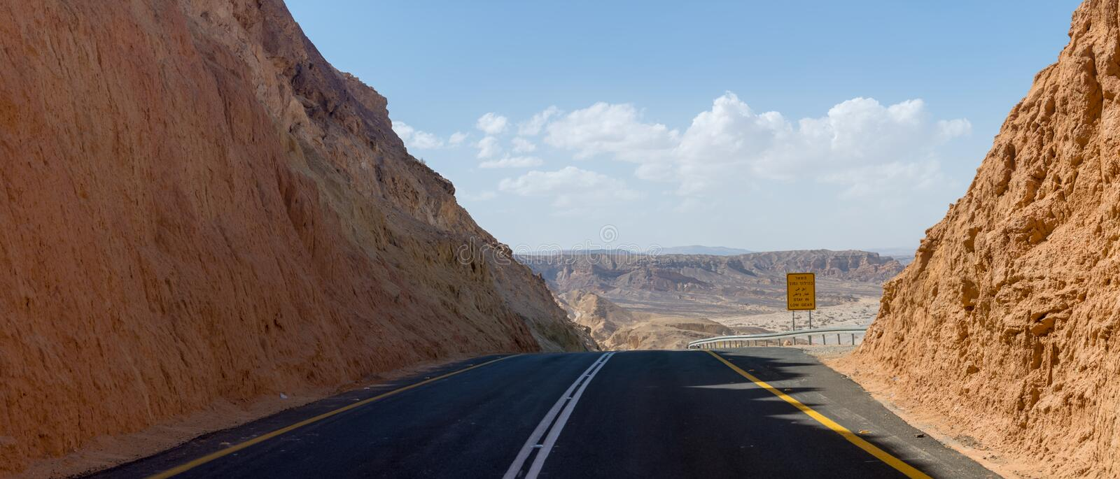 Asphalt road in desert Negev, Israel, road 40, transport infrastructure in desert, scenic mountains route from Eilat to north stock photography