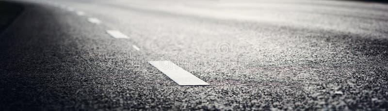 Asphalt road and dividing lines. Black asphalt road and white dividing lines stock photo