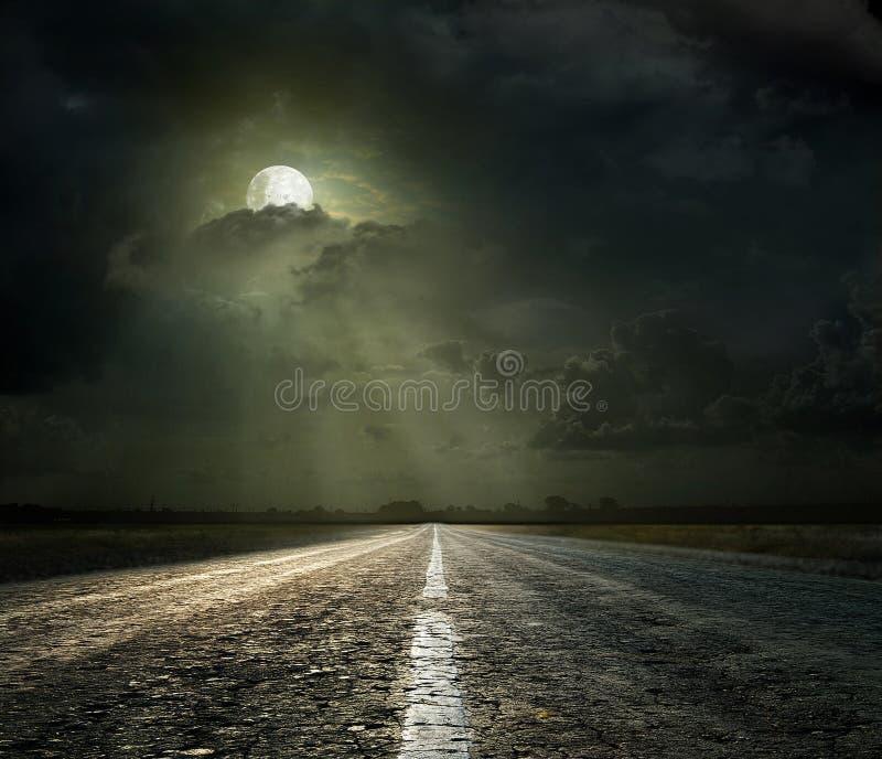Asphalt road. Dramatic sky over an asphalt road stock photo