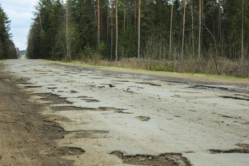 Asphalt road with holes royalty free stock image