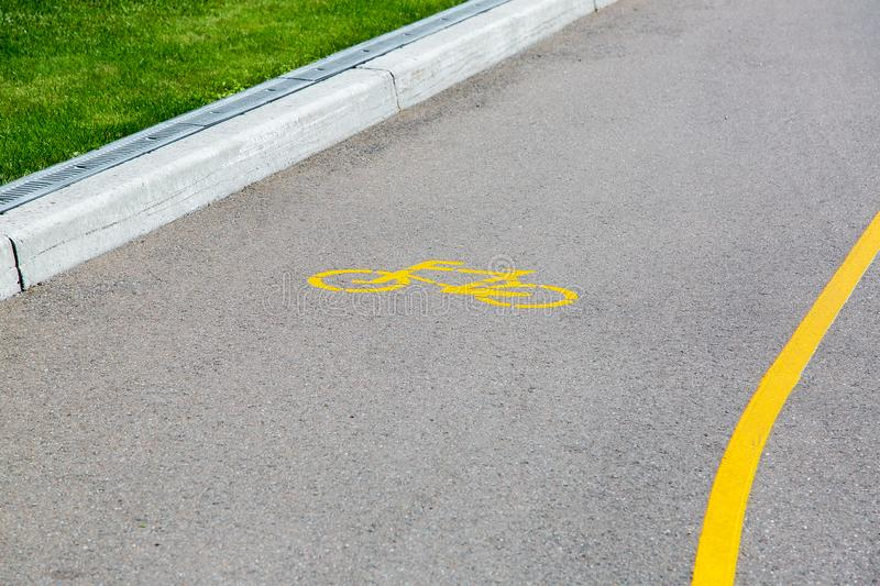 Asphalt road with a lane for bicycles. stock photography
