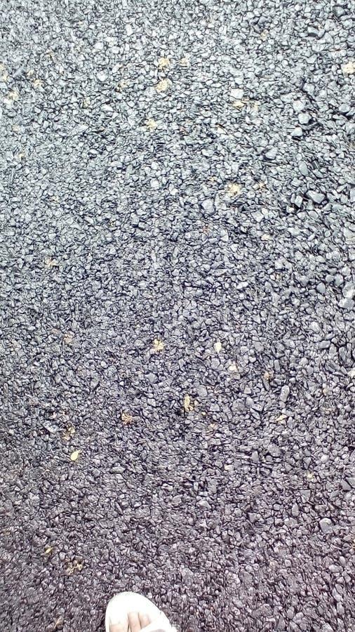Asphalt Road machte mit Teer und Steinschlägen Ein Hintergrund lizenzfreie stockbilder