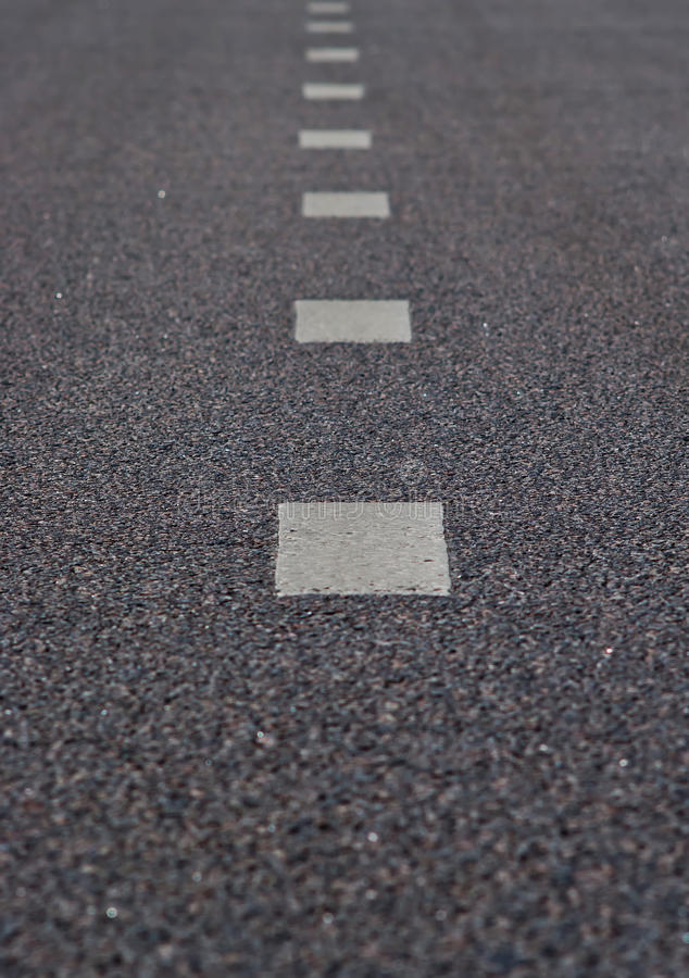 Asphalt road with a marking strips. Black and white color royalty free stock photography