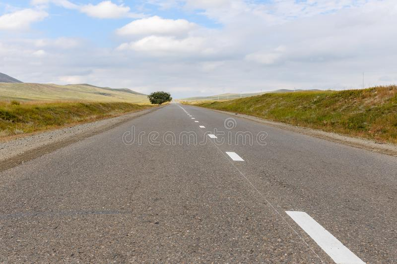 Asphalt road in Mongolia royalty free stock photography