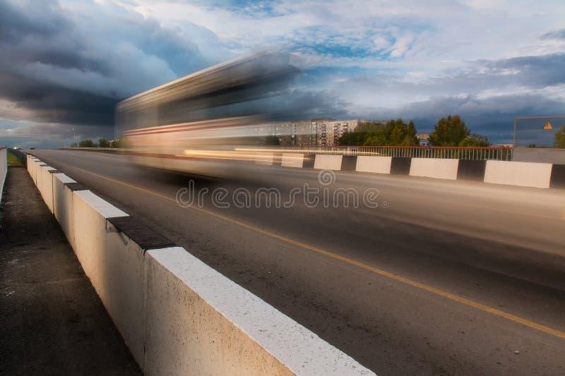 Asphalt road in motion blur. Asphalt road in motion blur at moody day royalty free stock images
