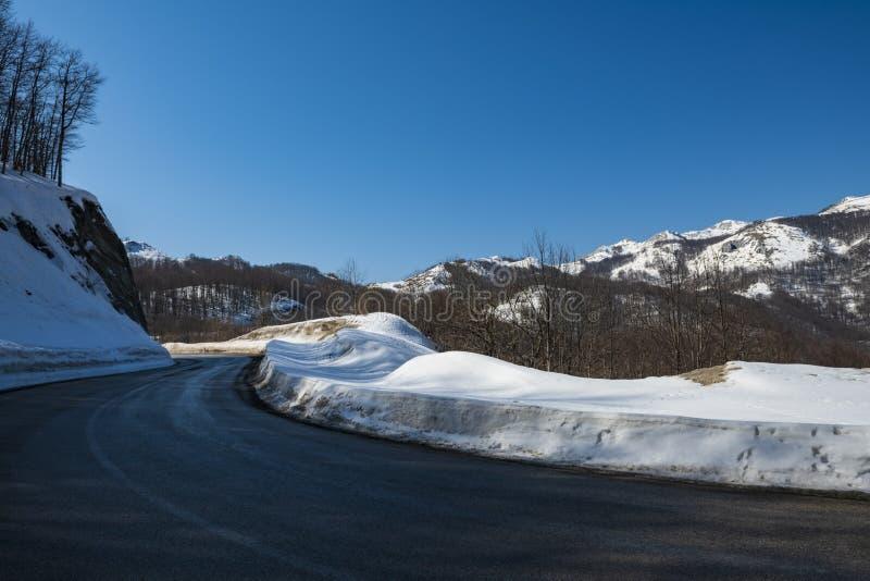Asphalt road through the mountain pass stock images
