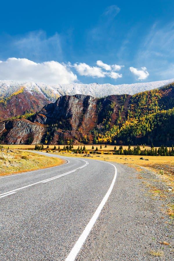 Asphalt road through a mountain valley stock photography