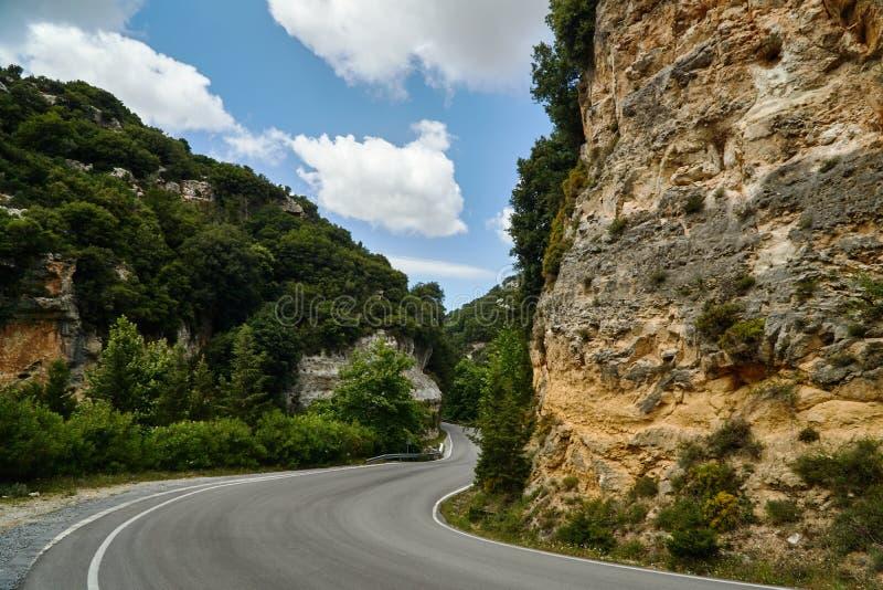 Asphalt road in a rocky ravine stock image
