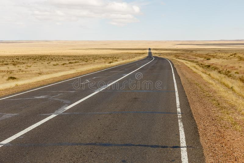 Asphalt road Sainshand Zamiin-Uud in Mongolia stock image