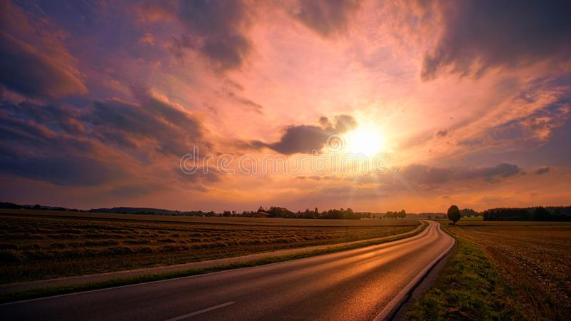 Asphalt Road during Sunset stock photography