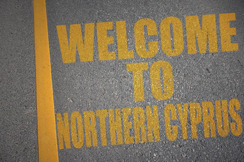 asphalt road with text welcome to northern cyprus near yellow line. royalty free stock photo