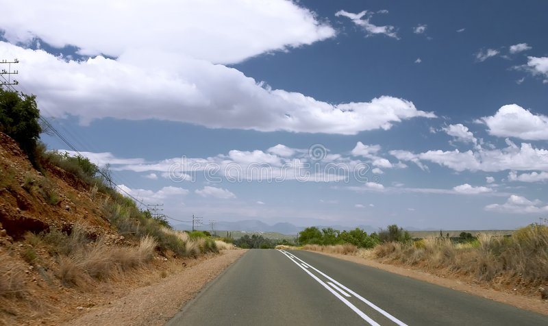 Asphalt road to the blue sky royalty free stock images