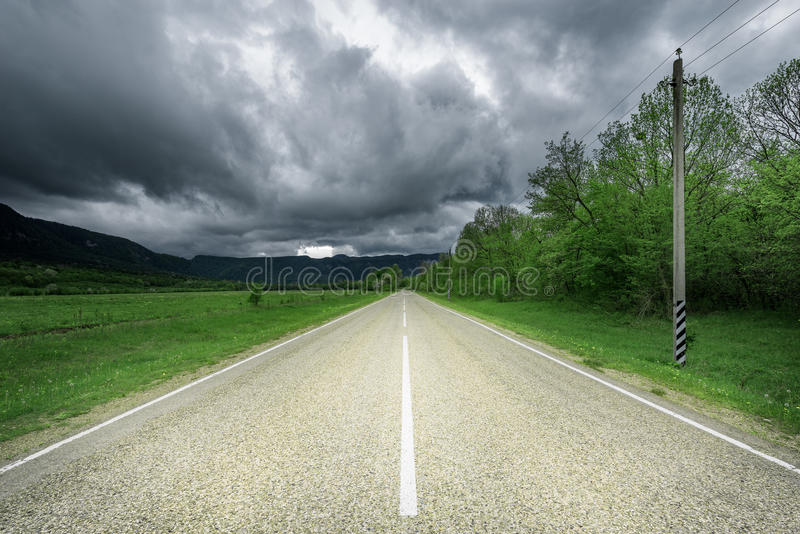 Asphalt road to the mountains. stock photography